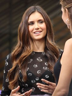 Nina Dobrev ... hair color is gorgeous, brown with caramel highlights.