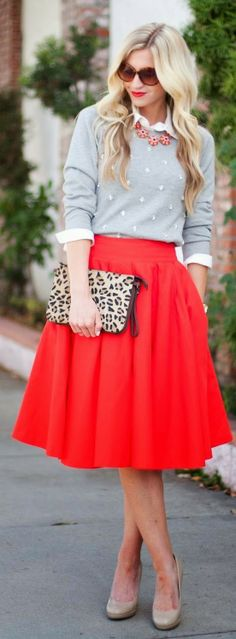 a grey sweater over a white blouse & red full skirt styled with nude pumps, a leopard print pouch & a statement necklace