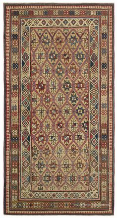 "DAGHESTAN - Northeast Caucasian, 3ft 4in x 6ft 3in, Circa 1875. Lovers of Caucasian tribal antique rugs often find themselves drawn to masterful risk-taking, inventive re-making of time-honored designs. Here the weaver-artist filled the classic Daghestan latticework pattern not with myriad tiny blossoms, but with larger scale, symbolic ""Star of Wisdom"" motifs."