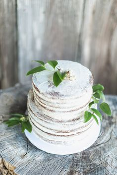 Wintery white wedding cake decorated with fresh greenery