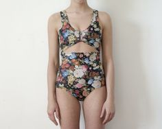 One Piece Floral Bather by minn0wbathers on Etsy $135. little weird...kinda LOVE it