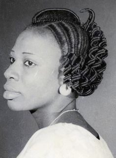 Vintage photo of African Woman with hair threaded. Very traditional hairstyle that was very popular in Nigeria once upon a time.