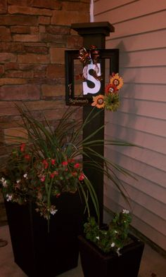 I saw a mini version on pintrest... But i needed to make a larger one for my corner on my porch ... I used an 6 x 6 x 8... And some extra wood we had to make the cap..... Painted it the same color as my front door.. Used a black coat hook to be able to hang seasonal decor.... I love that it give me the needed height I was wanting in that corner....