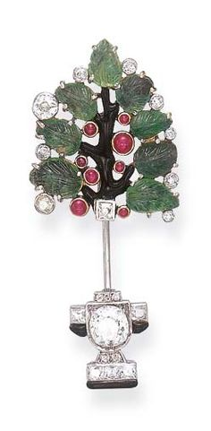 AN ART DECO GEM-SET AND ENAMEL JABOT PIN  Designed as a black enamel topiary, extending carved emerald leaves, accented by collet-set old European-cut diamonds and cabochon rubies, joined by a French and circular-cut diamond planter, centering upon an old European-cut diamond, with black enamel trim, mounted in platinum and gold, circa 1925