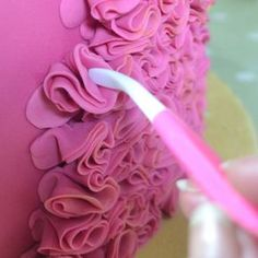 Ruffles can look so effective but they really are very easy to do. They are also great for a beginner because they can hide all sorts of imperfections in a base cake and look so professional. Here's how: You could make ruffles with plain fondant (sugar paste) but it is better to add a little strengthener such as Tylo Powder (also called CMC) or Gum Tragacanth. Gum paste (flower paste ) will also make pretty ruffles. Roll out your fondant so that it is nice and thin. Cut out a circle. The ...