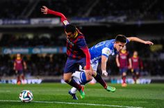 Pedro Rodriguez of FC Barcelona duels for the ball with Gastanaga of Real Sociedad during the Copa del Rey Semi Final second leg between Real Sociedad and FC Barcelona at Anoeta Stadium on February 12, 2014 in San Sebastian, Spain.