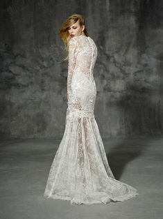 Sicilia from Yolan Cris wedding dresses 2016 -Long sleeve lace wedding dress made of different types of fabrics as guipure, embroidered tulle, macrames, laces, all creatively mixed using traditional hand sewn techniques-  see the rest of the collection on www.onefabday.com