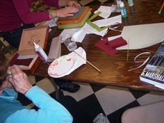 The ladies hard at work, creating purses and art out of cigar boxes. From the 10/10 class at The Rowayton Library.