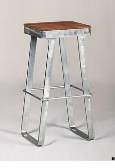 The Luxe Bar Stool is made of steel with a slatted teakwood seat. Cool Bar Stools, Industrial Bar Stools, Modern Bar Stools, Industrial Furniture, Industrial Lighting, Industrial Stairs, Industrial Cafe, Industrial Windows, Industrial Bedroom