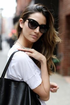 The white shirt Lily Aldridge is wearing is called the Caleb, named after her husband, Caleb Followill.