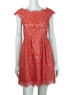 Prettily scalloped edges trimmed in delicate eyelash fringe define this flirty, feminien design.Scalloped necklineCap sleevesSkirt pleatsScalloped hemV back with concealed zipFully linedAbout 21 from natural waistCotton/rayon/nylonDry cleanMade in USA of imported fabric