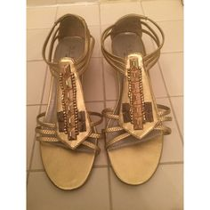 Gorgeous gold boho strapped sandals - These gorgeous boho strappy sandals are perfect for any occasion  - I LOVE these shoes but was given them as a gift and they are a size too big for me  - Gold color with straps around toes and ankle makes them super comfortable  - Adorable beaded design on the front  - Wedge measures to 2 inches but is very minimal  - Good condition, slight wear on bottom (see photo) but still have tons of life to them!  - Brand: New York Transit / DSW - Size: 9  *20%…