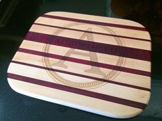 Family monogram on our custom made cutting board. http://www.maccuttingboards.com