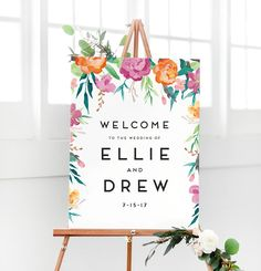 This wedding welcome sign features illustrated watercolor flowers and modern type for a chic look. You get to customize this wedding welcome sign with your names and date
