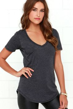 AS SEEN ON NIKKI REED!! Not only will the Z Supply Pleasant Surprise Washed Black Tee put a smile on your face, it'll also show off your fabulous style sense! The V neck, short sleeves, and patch pocket keep the classic tee look on this black top, but the jersey knit fabric has a burnout texture keeping it fresh and unique. Rounded hem brings the final touch.