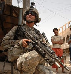 US soldier armed with a modern M249 Para - note the standard buttstock has been replaced with an after market collapsible one.