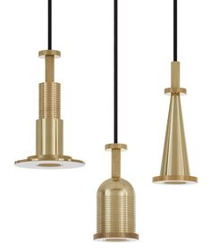Tom Dixon created a set of lights based on mechanical cogs to accompany his range of brass home accessories. ~ETS #lighting