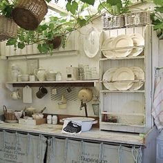 Love it. Shabby chic white kitchen in a potting shed.