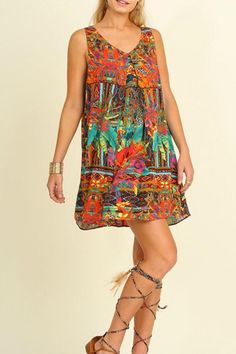 This super cute dress features a simple tiered design with a tropical floral print. Loose and airy fit. Slip this on and you'll be ready to hit up brunch and then the beach.  Tropical Paradise Dress by Umgee USA. Clothing - Dresses Dallas Texas