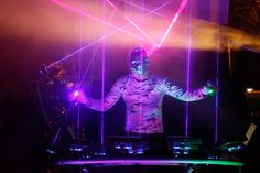 laser-light DJ. John Laraio of Mobius8 performed at the Fusion Fashion & Art Show December 6 at LMNT Contemporary Art Space.  Mobius8 is electronica performance art that combines lighting, visual  effects, and lasers that morph to the beat of dance music. Laraio  originally was booked for the UR1 festival, but when that event was cancelled he joined the Fusion event.