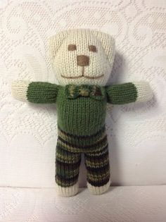 Hand knitted boy teddybear is 11 inches tall with an 8 inch arm span and filled with polyester fiberfill.  Teddybears make unique holiday/birthday gifts, baby arrival/christening gifts as well as baby shower table centerpieces!  He costs $15.00 plus shipping.  First Class Shipping costs $4.54 and Priority Mail costs $7.15 in the USA!  If interested in purchasing, send me a message with your zip code