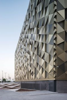 Futuristic Architecture Discover Enero Arquitectura creates second skin with metallic lattice for thermal comfort at Cordoba Hospital Factory Architecture, Healthcare Architecture, Islamic Architecture, Futuristic Architecture, Facade Architecture, Mall Facade, Retail Facade, Facade Design, Exterior Design