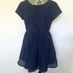 """Navy Patterned Fit and Flare Dress This gorgeous dress would be perfect for any occasion. Pair it with some pumps and be date night ready. The outer layer of the dress is a checker pattern with some of the squares shiny and some flat. All one color. It is fully lined.   Size L  Bust 36"""", Length 33""""  100% polyester Hand Wash  Previously owned, still in perfect condition Forever 21 Dresses"""