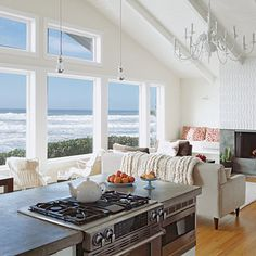 Instead of walling off the kitchen and dining room, keep everything open for a studio-like floor plan.   Coastalliving.com