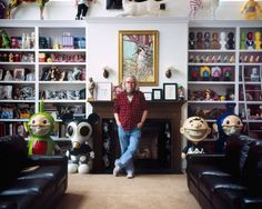 Ron English at home, surrounded by his toy collection