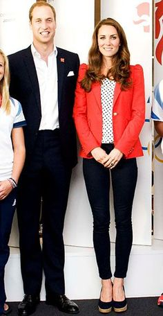 Catherine Middleton, Duchess of Cambridge, visited athletes on Team Great Britain in a polka-dot blouse, navy skinnies, Stuart Weitzman wedges, and a red Zara blazer.
