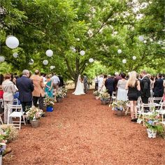 Lawrence and Kate became husband and wife in an outdoor ceremony under the pecan trees on Kate's family farm. She arrived at the ceremony sitting on the back of her brother's vintage car, whilst her bridesmaids and dog walked behind her.