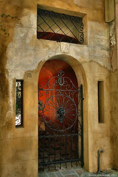 Iron Gate & Stucco Wall