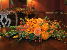 A Thanksgiving Centerpiece, long, low, and narrow, using Autumn colors and tiny pumpkins