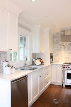 white marble kitchen by Sarah Gallop