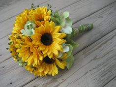Sunflower and Hydrangea Wedding Bouquet. $75.00, via Etsy.