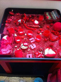 Little Red Riding Hood red sensory rice tray recycled bottle tops sequins glitter Pom poms feathers tins to open & close or fill cups red plastic jelly bowls.