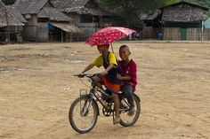 Burmese children share a bicycle inside the Mae La refugee camp in Tak province, Thailand. The camp is situated along the Burma-Thailand border and is home to around 50,000 refugees. Mae La is the largest of nine camps along the Thai border where the Burmese live in a stateless limbo for many years.