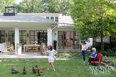 It's always a family affair at author Kathryn Stockett's home. Stockett's mother, Ruth, and daughter, Lila, enjoy the backyard, which includes a covered porch with seating and living areas for entertaining and a chicken coop.