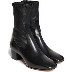 Gigi Hadid wearing Sandro Paris Amele Ankle Boots