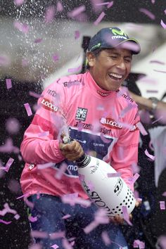 Colombia's Nairo Quintana celebrates on the podium after winning the Giro D'italia, in Trieste, Italy, Sunday, June 1, 2014. Nairo Quintana confirmed himself as cycling's next star by winning the Giro d'Italia on Sunday to follow his runner-up finish in last year's Tour de France. The 24-year-old climbing specialist with the Movistar team won two stages and finished with a 3 minute, 7 second advantage (AP Photo/Fabio Ferrari)