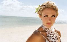 Pull back your bangs and add a beachy flower to your pixie cut for an on-the-beach wedding! From Wedding Hairstyles.   For more info on Destination Weddings: http://www.paradisegetaways.net/default.aspx