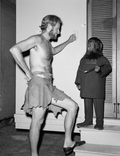 """Billy Curtis, in a gorilla costume, chats with Charlton Heston on the set of """"The Planet of the Apes"""" in 1967."""