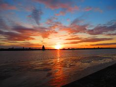Sunset over Wirral from Kings Dock Liverpool.