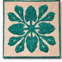 hawaiin quilt...it must be the pennsylvania dutch in me, but i'm a sucker for a pretty quilt, & the hawaiin patterns are especially beautiful.