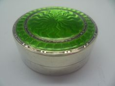 An English, Art Deco, sterling silver and guilloche enamel pill box, made by Liberty & Co. in Birmingham in 1928