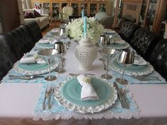 Delicate and pretty setting using white, robin's egg blue, and silver.  Esp love the placemat with lacy edge and the pearly napkin ring.