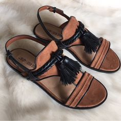 Black & Brown Suede Tassel Sandals New in box. Brown faux suede with black faux leather sandals. Black fringe tassels in front. Adjustable ankle straps. ❌NO TRADES OR PAYPAL❌ Leila Stone  Shoes Sandals