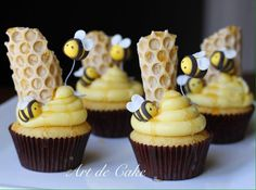 Bumble Bee Cupcakes with honeycomb and buzzing bees around the beehive by Art de Cake