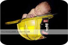 Baby in a fire helmet