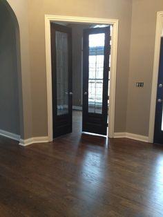 @Jason Fehlner - Our house - dark floors, grey walls, black doors, white trim. Beautiful. Rocky Bluffs paint color
